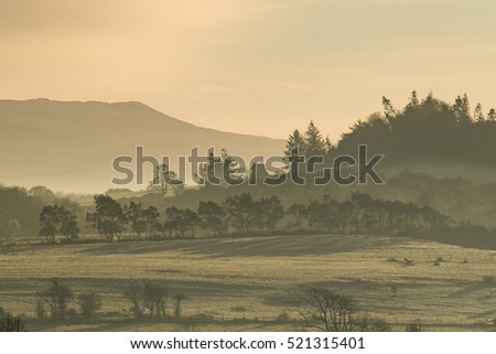 Cold hazy frosty winter morning sunrise landscape in County Kerry, Ireland