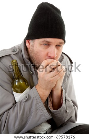 cold homeless tramp with empty bottle warming hand over white background