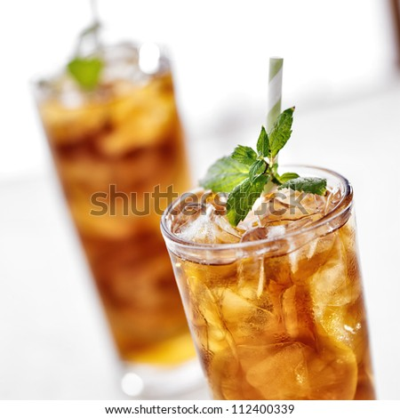 cold iced tea with mint garnish and lemon slices - stock photo