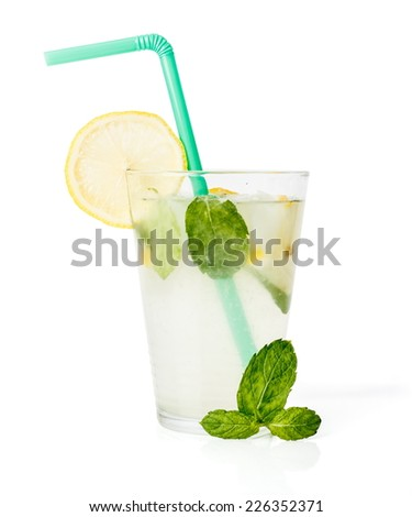 Cold lemon squash with ice cubes and mint leaves - stock photo