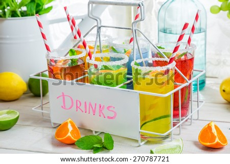 Cold lemonade with citrus fruits - stock photo
