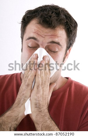 cold man wiped his nose with a tissue - stock photo