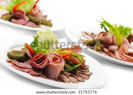 Cold Meat Dish - Sliced Meat Plate  with Fresh Salad Leaf and Pickled Vegetables - stock photo