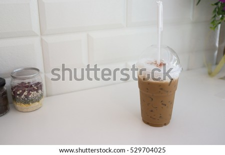 Cold milk coffee and ice in glass