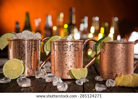 Cold Moscow Mules - Ginger Beer, lime and Vodka on bar - stock photo