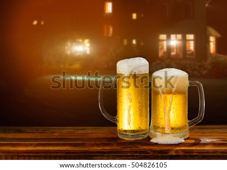 cold mug of beer in a landscape