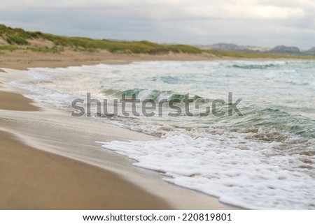 Cold North sea sandy beach in Norway - stock photo