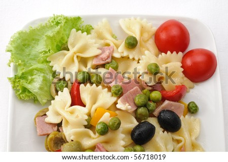 Cold pasta, farfalle with vegetables - stock photo