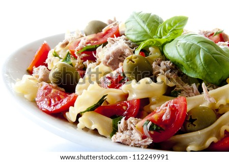 cold pasta salad with tuna tomatoes and olives - stock photo