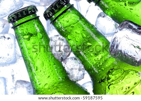 Cold perfect beer in blue background in ice - stock photo