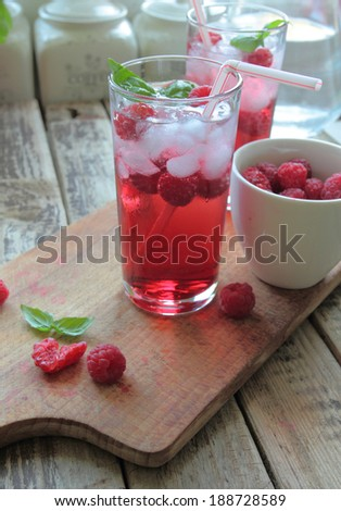 Cold rasberries drink with fresh fruits - stock photo