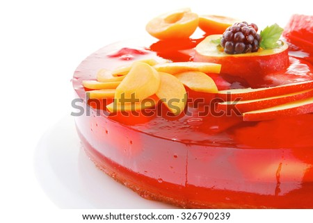 cold red jelly cake with peach and nectarine - stock photo