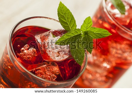 Cold Refreshing Berry Hibiscus Iced Tea with Mint - stock photo