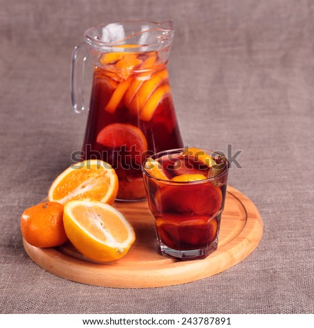 Cold refreshing drink from berries in glasses on the wooden table - stock photo