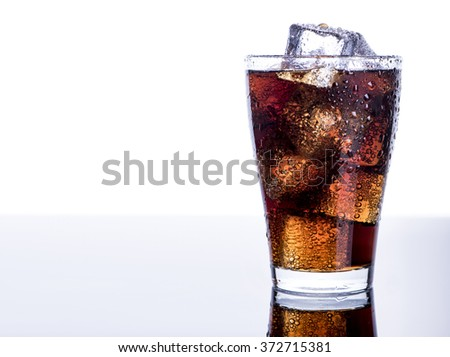 Cold refreshing soft drink with ice on an isolated white background