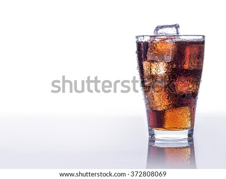 Cold refreshing soft drink with ice on an isolated white background - stock photo