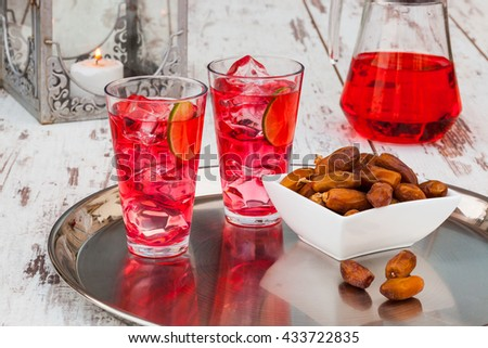 Cold refreshing syrup drink, sweet dates and fruit for iftar break fast during fasting month of Ramadan. - stock photo