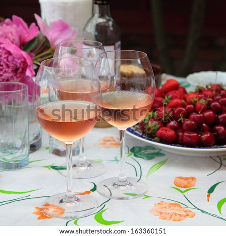 Cold rose wine and fruits  - stock photo