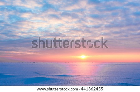 Cold Skies Setting Sun  - stock photo