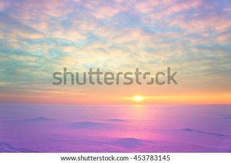 Cold Skies Setting Sun  - stock photo