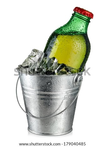 Cold small beer bottle in a bucket with ice