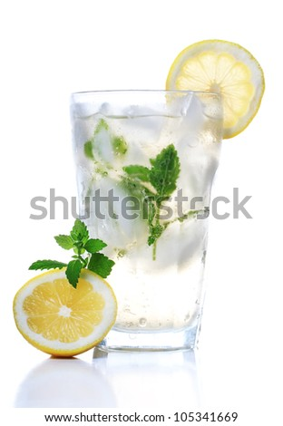 Cold soft drink with lemon and mint - stock photo