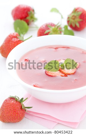 cold soup with strawberry on plate