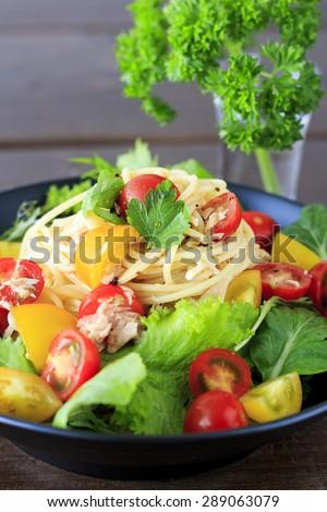 Cold spaghetti with tuna and fresh tomato - stock photo