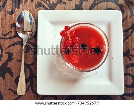 Cold strawberry soup with cranberry as topping