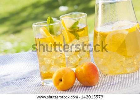 cold summer drinks in garden - stock photo