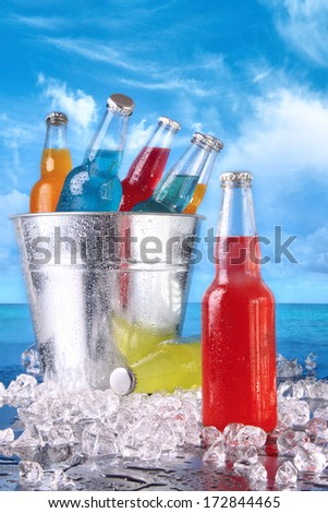 Cold summer drinks in ice bucket on the beach - stock photo