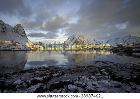Cold Sunrise over Reine, Lofoten islands, Norway in winter - stock photo