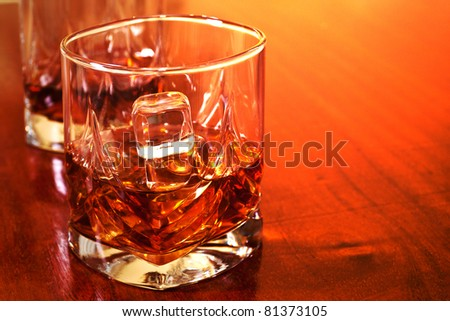 cold sweet taste of whiskey with ice in a glass