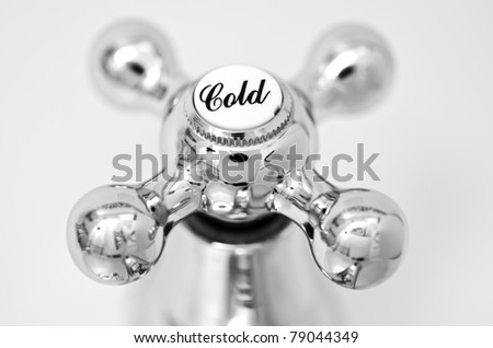 Cold tap; close-up image of cold tap or faucet, covered with condensation; strong differential focus - stock photo