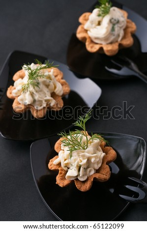 Cold tartalette with cheese cream and dill - stock photo