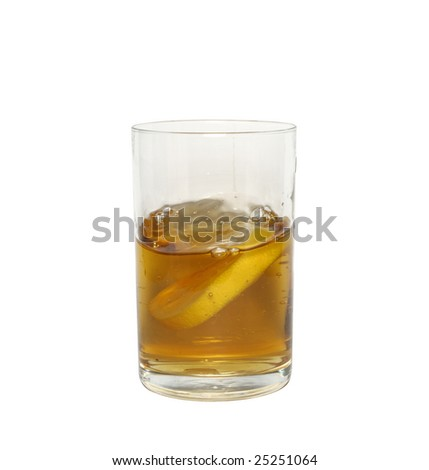 cold tea with a lemon in glass