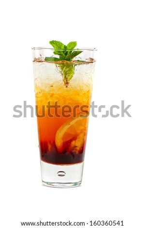 cold tea with ripe ginger, lemon, mint and ice on white