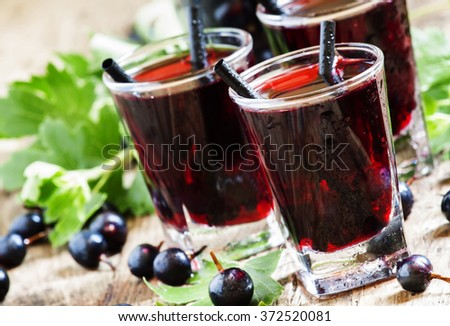 Cold vodka with blackcurrant juice and fresh berries, selective focus - stock photo