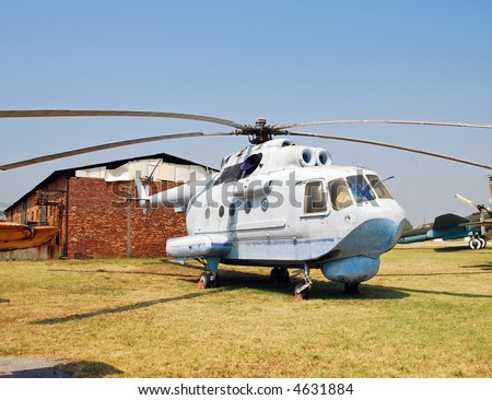 Cold War era Russian made helicopter parked in remote airfield - stock photo