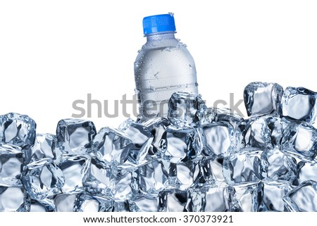 Cold Water Bottle In Ice Bucket with Ice Cubes - stock photo