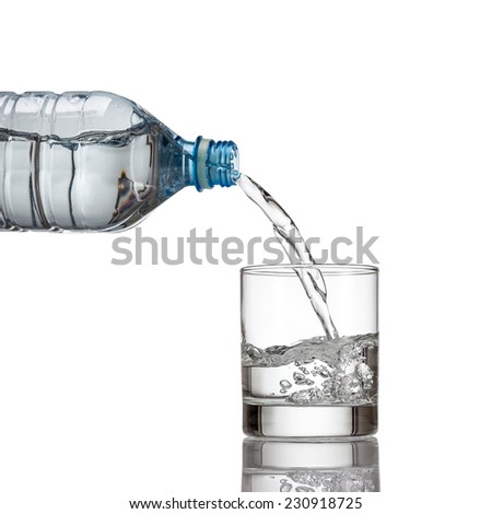 Cold water bottle pour water to glass on white background - stock photo
