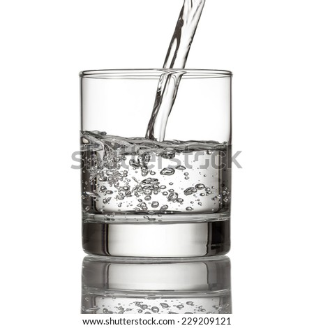 Cold water pour water to glass on white background - stock photo