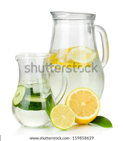 Cold water with lemon, cucumber and ice in pitchers isolated on white - stock photo