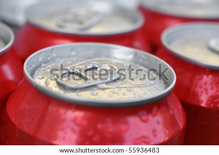 Cold wet cans of soda or beer - stock photo