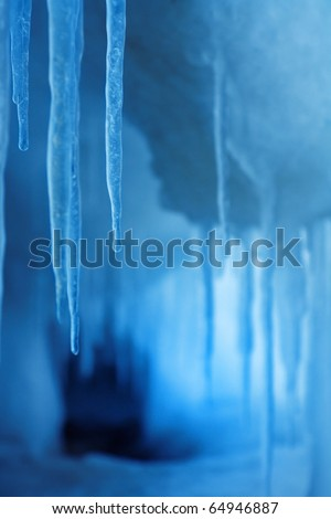 Cold winter and the waves gave fanciful ice patterns. - stock photo