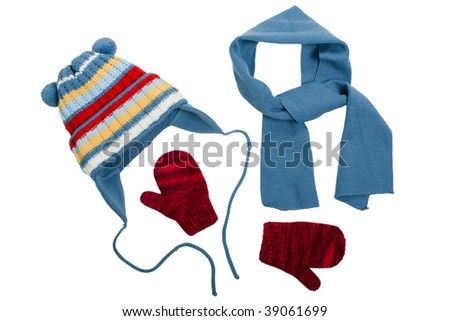 Cold winter clothing - hat or cap, scarf, mitten - stock photo