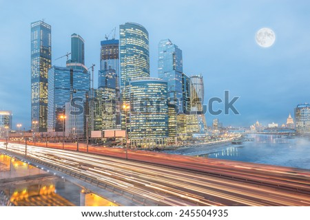 Cold winter morning view of the road and business city center by the river.  - stock photo
