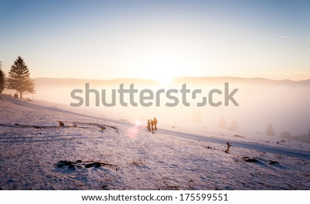 Cold winter sunset with people - stock photo