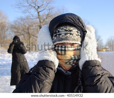 Cold winter woman covering herself from the cold. - stock photo