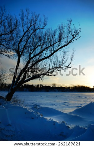 Coldest winter sunset, river landscape, Quebec, Canada